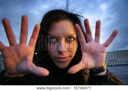 Scary portrait of a young woman with palms open. Close-up.