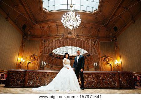 Magnificent Wedding Pair Newlywed At Rich Wooden Royal Palace.