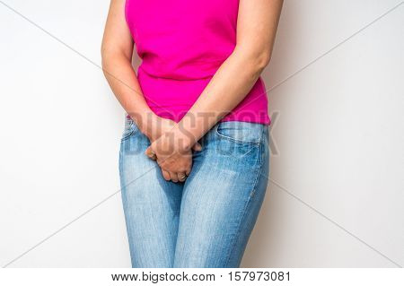Woman With Hands Holding Her Crotch - Incontinence Concept