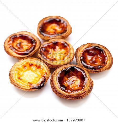 Typical portuguese dessert pasteis de nata isolated on white background close up