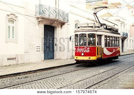Lisbon Portugal - January 19 2016 - Typical yellow tram number 28 in the city center of Lisboa