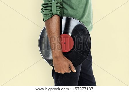 African Man Holding Vinyl Disc Jockey Music Concept