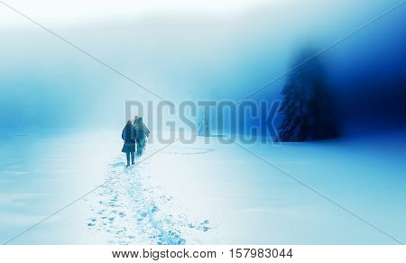 People alone in Winter blizard. Beautiful mountain snowy landscape