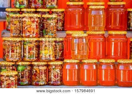 Pots with different sorts of honey in Russian marketplace