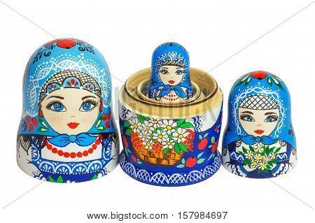 Three traditional Russian matryoshka dolls. Painted matryoshka. Matryoshka blue composite