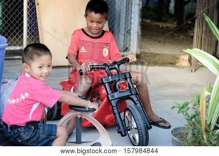 Roi Et Thailand - November 4 2016: Asian children in rural areas are happy with a new toy to his friend in Roi Et Thailand