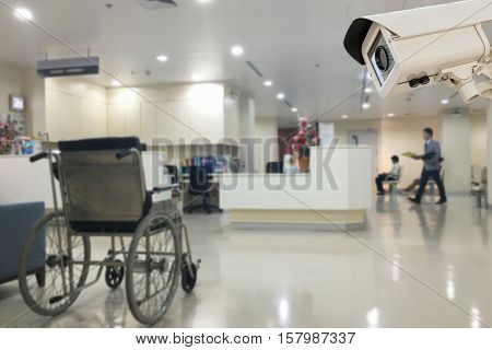 The CCTV security camera operating in office hospital blur background.