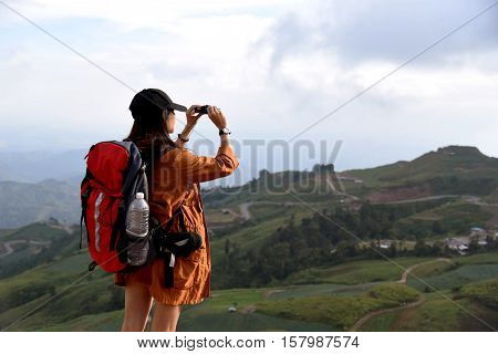 Young Travelers Are Using Binoculars Front View Nature.