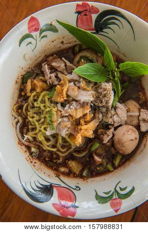 closeup Thai noodles with boiled in a bowl. ( Moo nam tok)