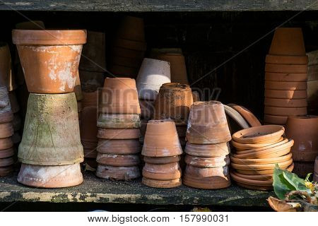 Old rustic vintage stacks of terracotta flower pots