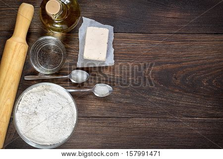 Baking Ingredients And Kitchen Utensils For Pizza Dough.