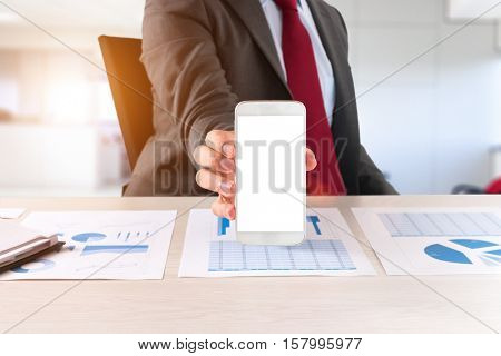 Businessman showing his mobile phone empty screen. Sun flare effect