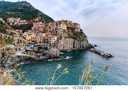 Sunset over Manarola. Small coastal village in the Italian region of Liguria Cinque Terre. Province of La Spezia. UNESCO World Heritage List. Italy