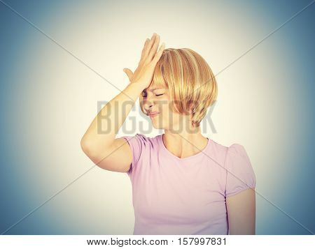 Witless Young Woman Holding Her Hand To Her Forehead