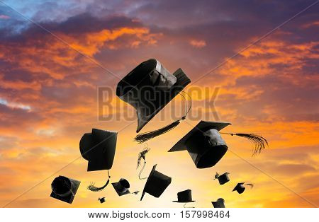 Graduation Ceremony, Graduation Caps, Hat Thrown In The Air Sunset Sky Abstract Backgrpund.