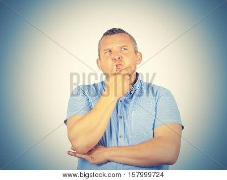 Fat Man  Chin On Hand Thinking Daydreaming, Staring Thoughtfully Upwards,