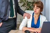 Man touching woman's shoulder - sexual harassment in business office poster