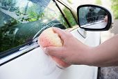 close up of white car is washing in soap suds poster