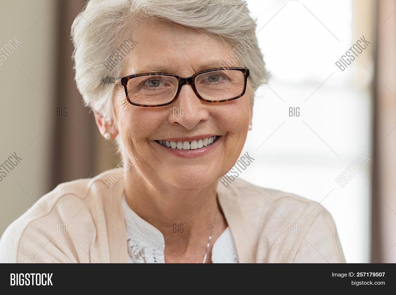 9fb0e242b3e0 Portrait of a happy senior woman wearing eyeglasses. Beautiful elderly  woman with eyeglasses smiling at