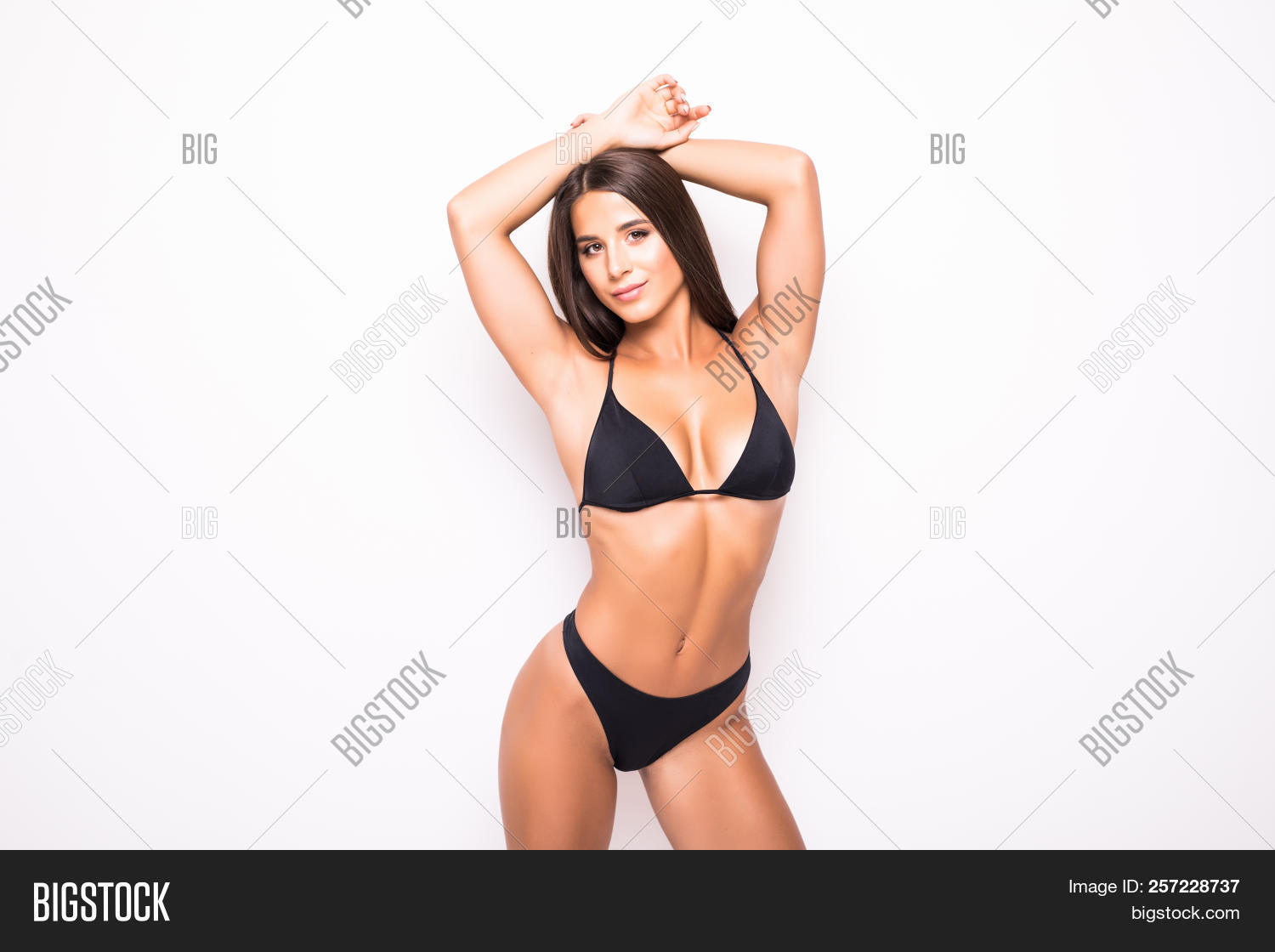 d72c8d5ae65 Slim body of young woman in black bikini. Girl with healthy sporty figure  isolated on white background