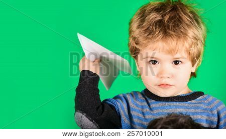Plane. Child Playing Throwing Paper Airplane. Travel And Vacation Concept. Kid Boy Pilot Playing Wit