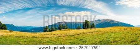 Great Panorama Of Mountainous Landscape. Gorgeous Cloudscape Above Wide Grassy Meadow. Mountain Ridg