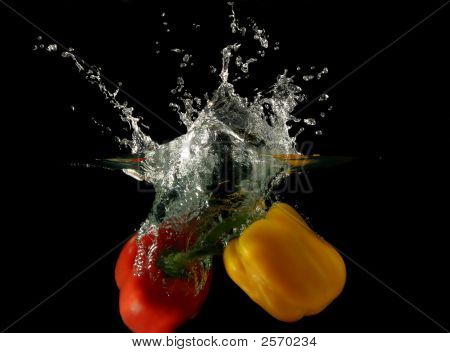 A Photo Of A Vegetables - Peppers Dropped Under Water