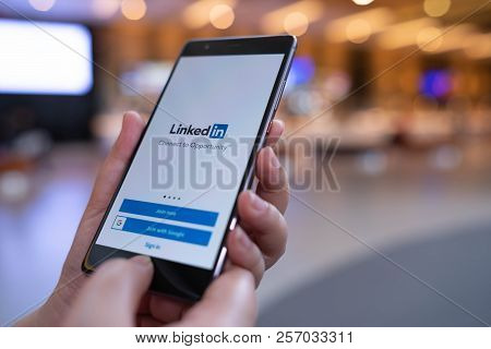 Chiang Mai, Thailand - August 03,2018: Woman Hands Holding Huawei Mobile Phone With Linkedin Applica