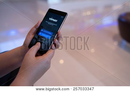 Chiang Mai, Thailand - August 03,2018: Woman Hands Holding Huawei With Vimeo On Screen.  Vimeo Is A