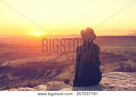 A Girl In A Hat On Top Of A Hill In Silence And Loneliness Admires A Tranquil Natural Landscape In S