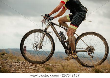 Closeup Dirty Cyclist Mountainbiker Background Grey Sky