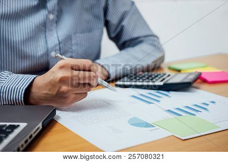 Business Man Or Accountant Working Financial Investment On Calculator With Calculate Analyze Busines