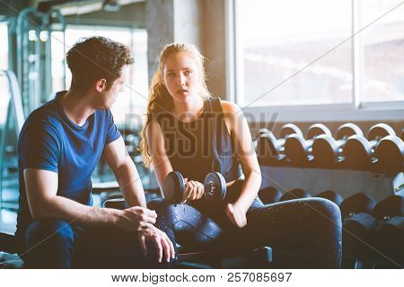 Fit Beautiful Young Woman Caucasian Attractive Fitness Woman Exercise With Dumbbell By Trainer In Gy