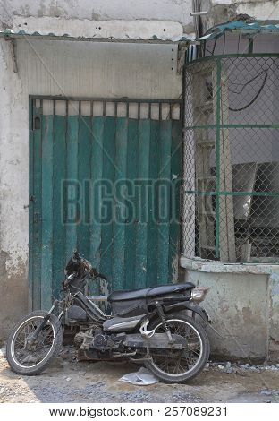 A doorway in a small residential back street in the Tran Hung Alleys area of District 1 in Saigon. poster