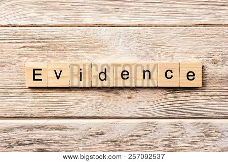 Evidence Word Written On Wood Block. Evidence Text On Table, Concept.