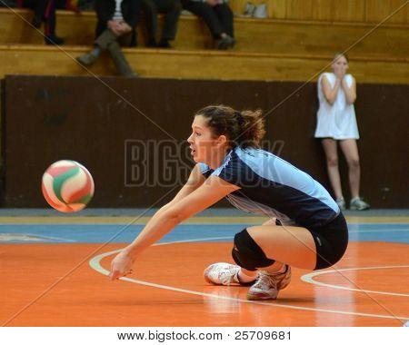 KAPOSVAR, HUNGARY - OCTOBER 16: Karmen Kovacs in action at the Hungarian NB I. League woman volleyball game Kaposvar (blue) vs Ujpest (white), October 16, 2011 in Kaposvar, Hungary.