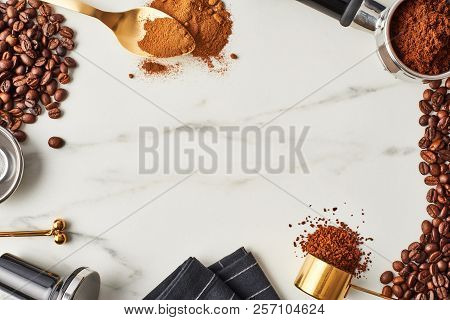 Flat Lay Of Coffee Background. Assorted Coffee Beans, Ground And Instant Coffee On Marble Background