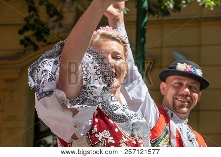 Prague, Czech Republic - July 1, 2018: People In Moravian Folk Costumes Parading At Sokolsky Slet, A