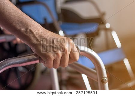 Asian Old Woman Standing With Her Hands On A Walker Stand,hand Of Patient Woman Holding A Walking Ai