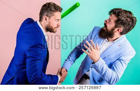 Hidden Threat Concept. Business Partners Competitors Office Colleagues Shaking Hands. Tricky First I