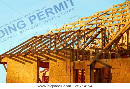 House Under Construction with Building Permit in Background