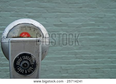 Expired Parking Meter in front of Blue Brick building