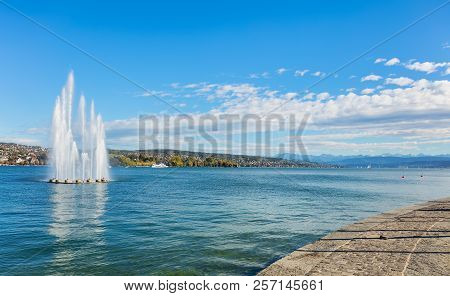 Lake Zurich In Switzerland, Summits Of The Alps In The Background - View From The City Of Zurich At