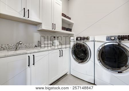 White Clean Modern Laundry Room With Washer And Dryer
