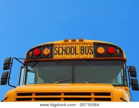 Front of School Bus Under Blue Sky