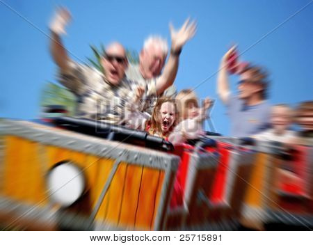 Father and Daughter On Amusement Park Roller Coaster with Zoom Blur poster