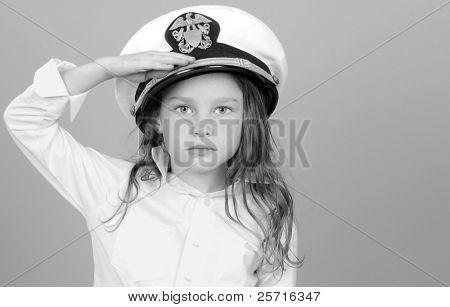 Young Girl in U.S. Navy Hat Rendering Salute