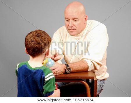 Father Showing Son a Globe