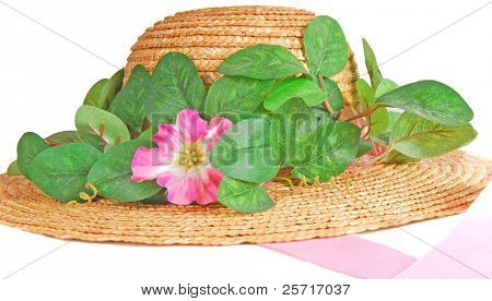 Pretty straw hat with flowers and pink ribbon