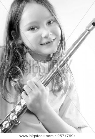 Young girl holding flute